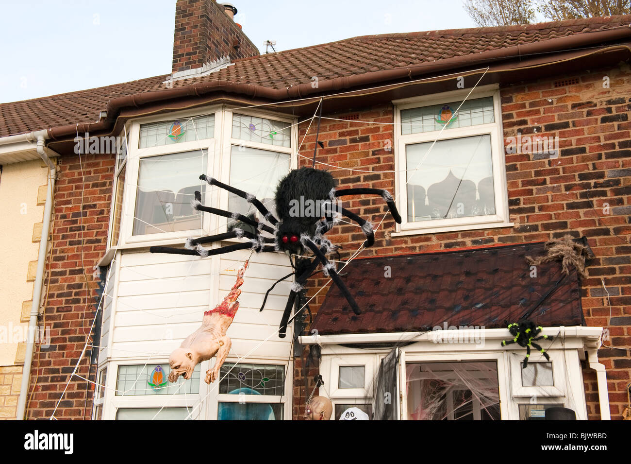 huge spider and halloween decorations on house