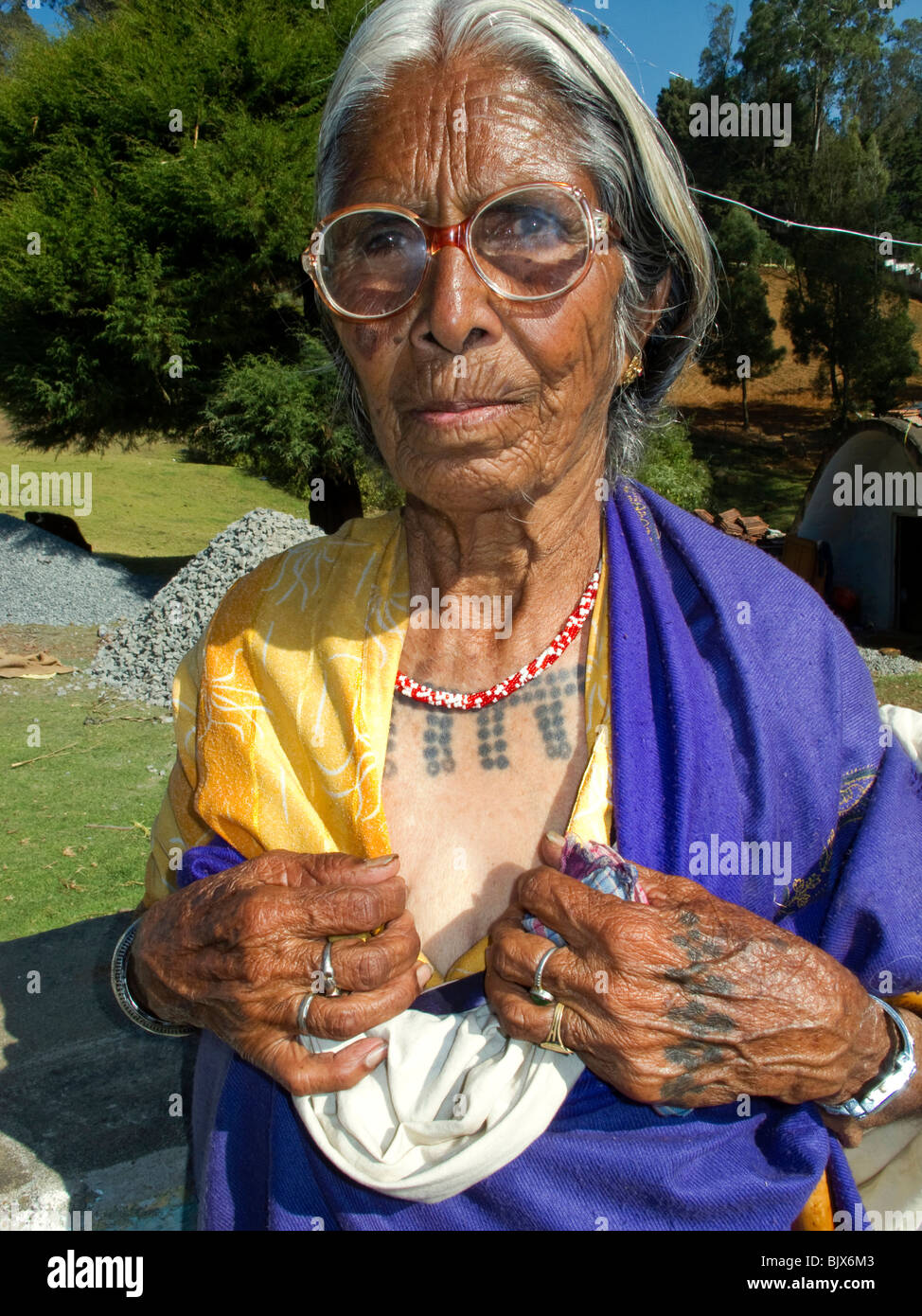 India, <b>Tamil Nadu</b>, Udhagamandalam (Ooty), Toda tribal woman displaying ... - india-tamil-nadu-udhagamandalam-ooty-toda-tribal-woman-displaying-BJX6M3