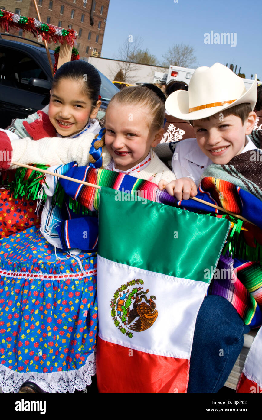 Three Hispanic and white kids in traditional Mexican ...