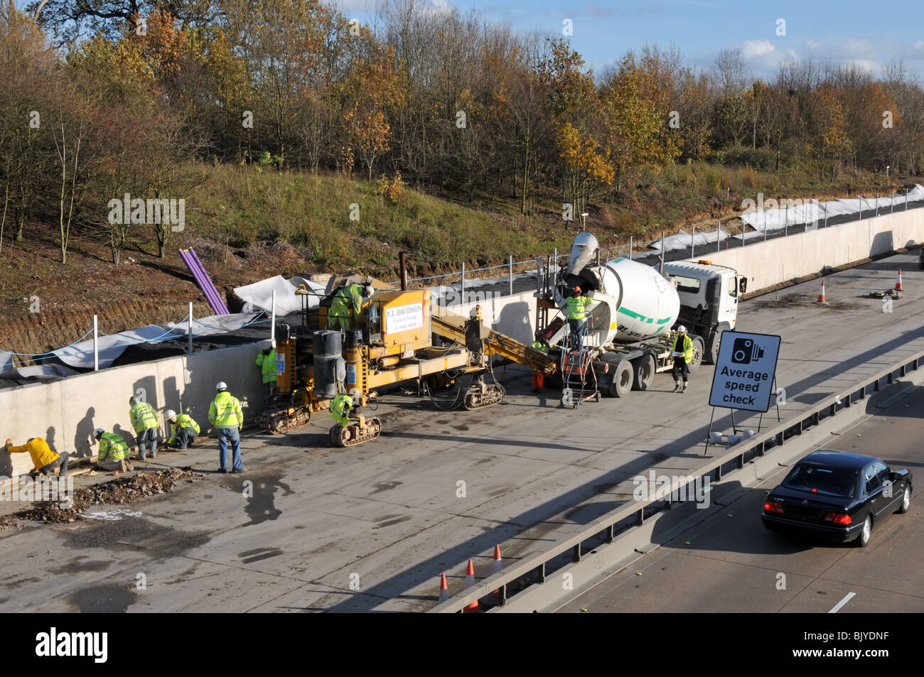 M25 motorway widening to four lanes slip form paving machine and concrete trucks