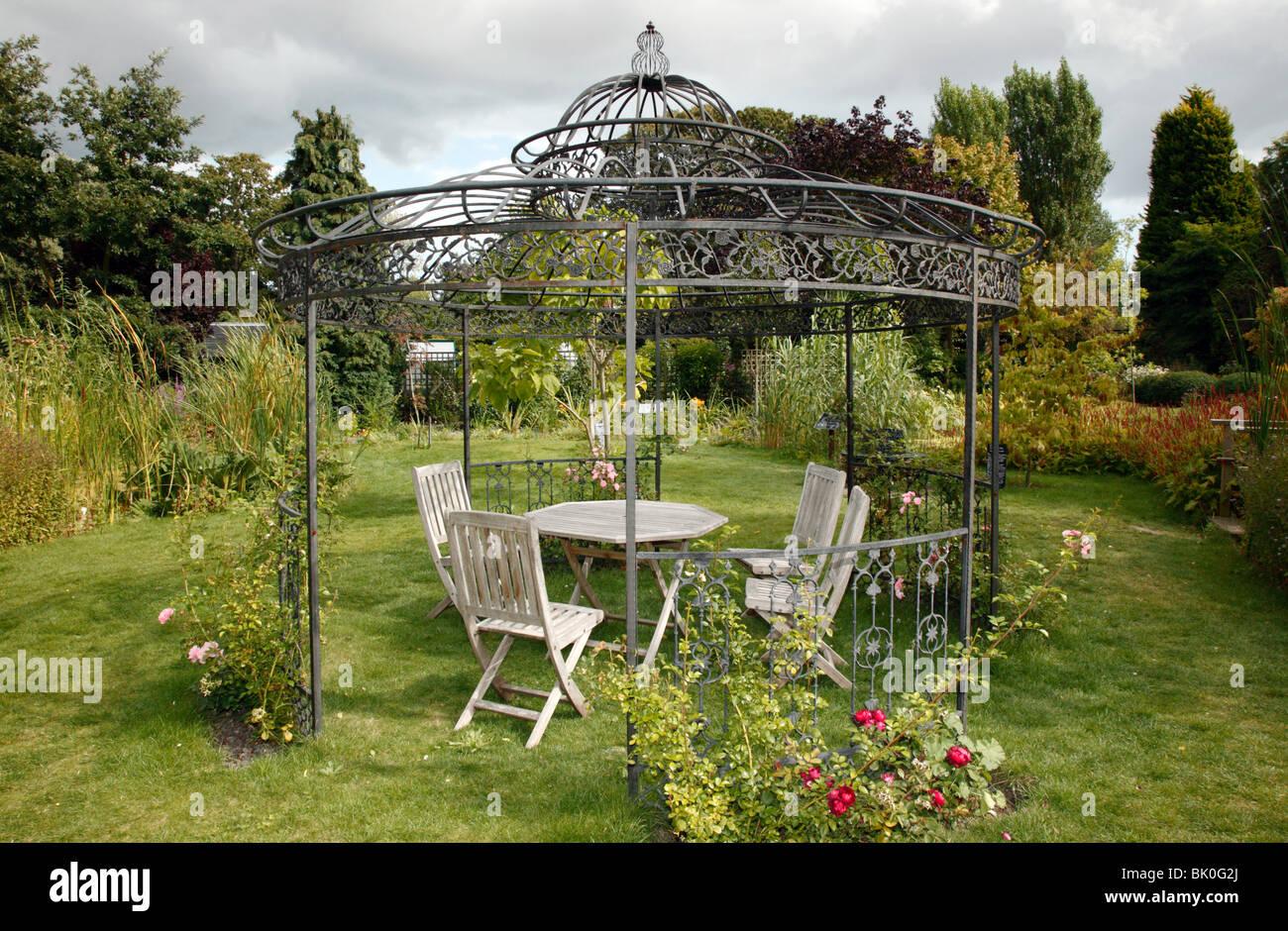 Garden Furniture Gazebo large metal gazebo containg garden furniture, in the secret