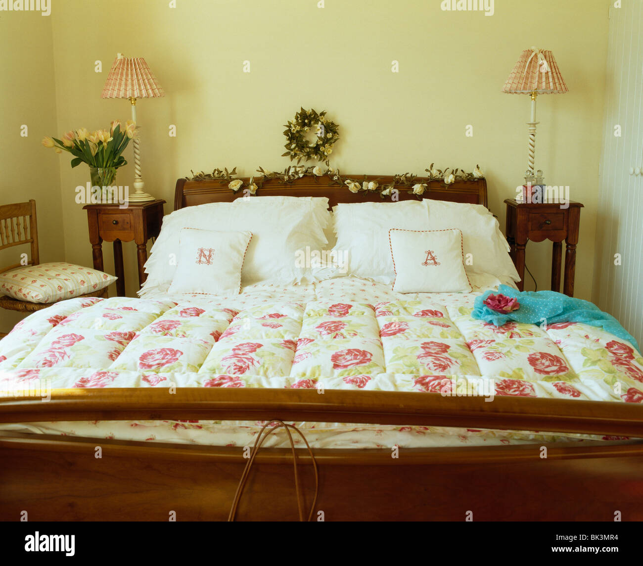 Rose-patterned quilt and white pillows on mahogany bed in country ... : patterned quilt - Adamdwight.com