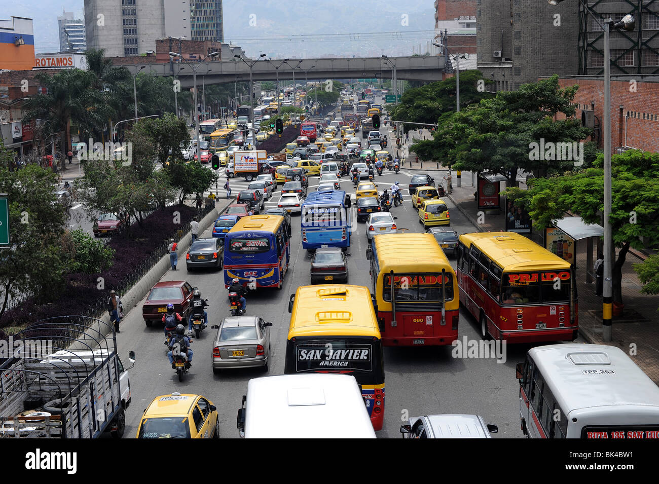 Lanes of cars, buses, taxis on busy highway in Medellin Stock ...