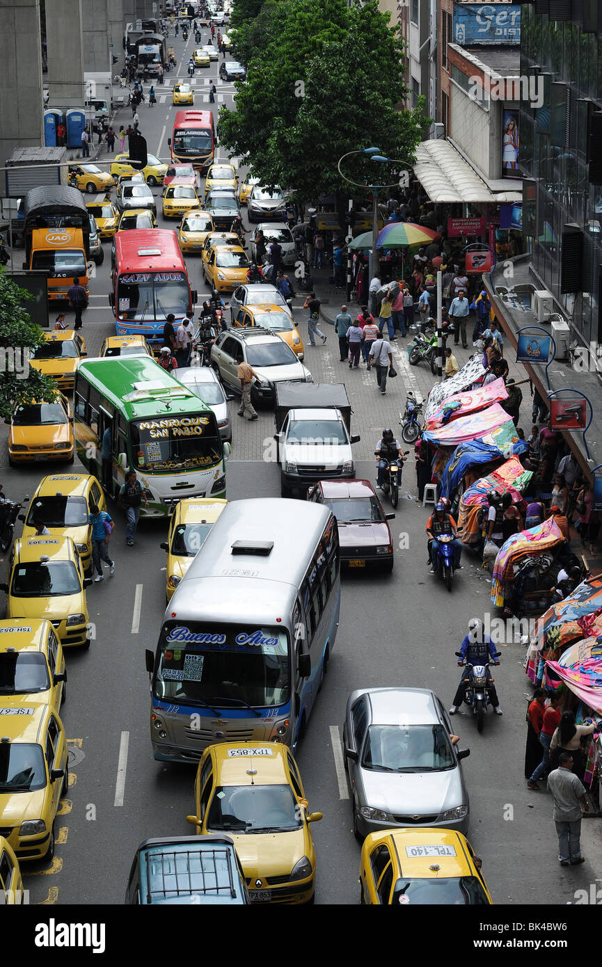 Lanes of cars, taxis, buses on busy road in Medellin Stock Photo ...