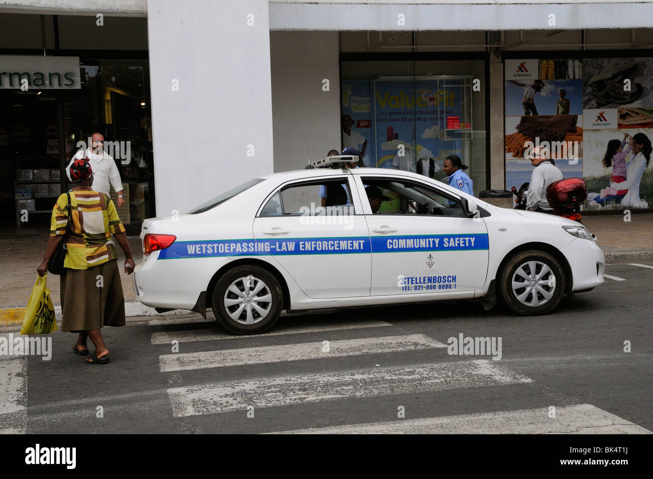 law enforcement police car parked on a pedestrian crossing stock
