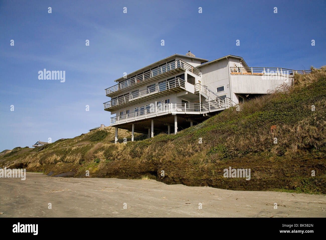 Attractive Beach House Newport Oregon Part - 5: ... A Beach House Sits On Eroded Sand Dunes By Pacific Ocean Waves And High  Water In