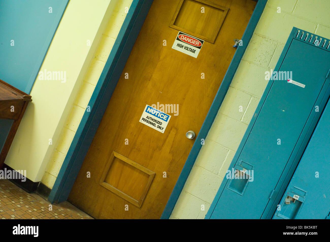 Door with warning notices beside school lockers & Door with warning notices beside school lockers Stock Photo Royalty ...