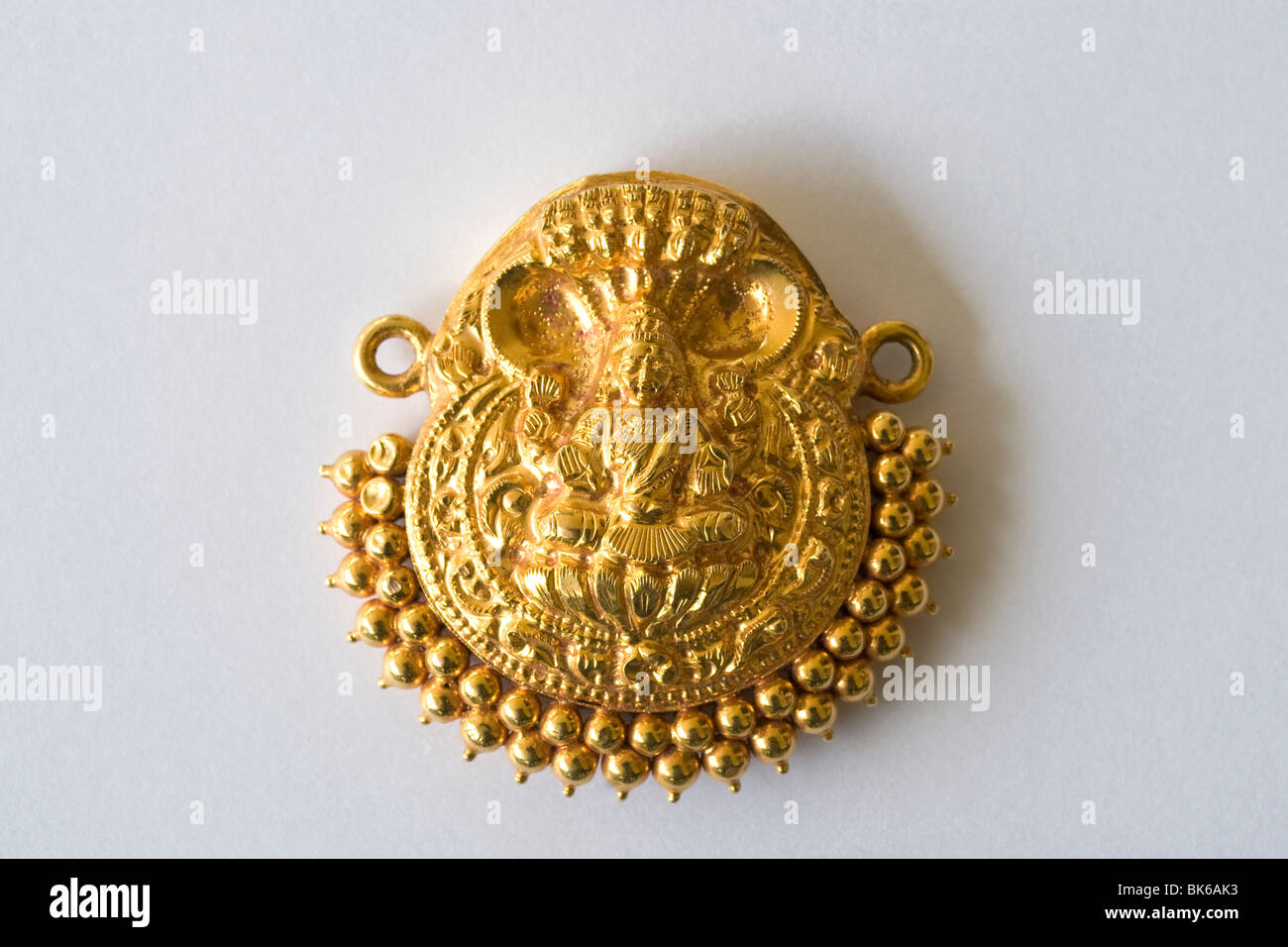60 years old gold ornamental lakshmi pendant stock photo royalty 60 years old gold ornamental lakshmi pendant mozeypictures Gallery