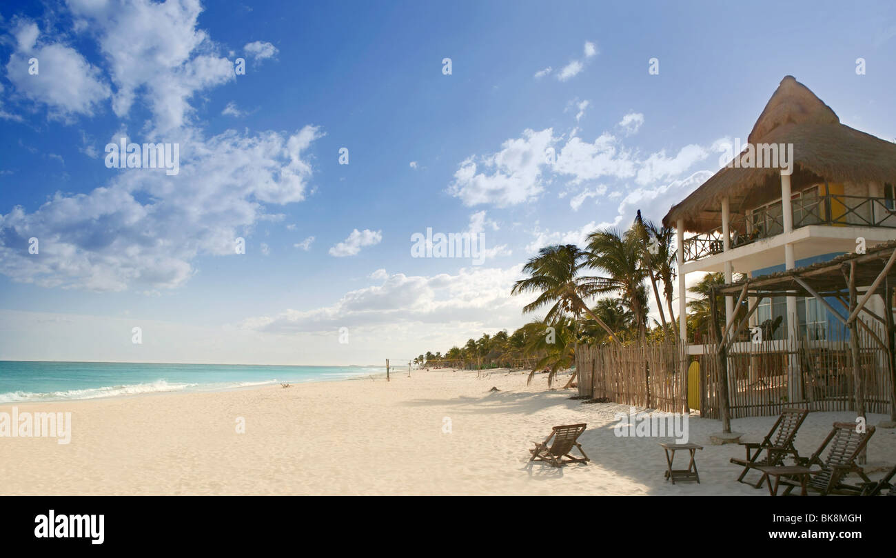caribbean sand beach tropical houses in mexico mayan riviera stock