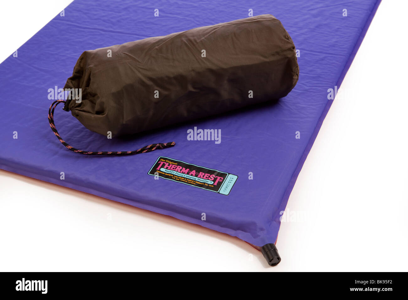 camping equipment therm a rest self inflating camping mattress inflated and packed in compact sack