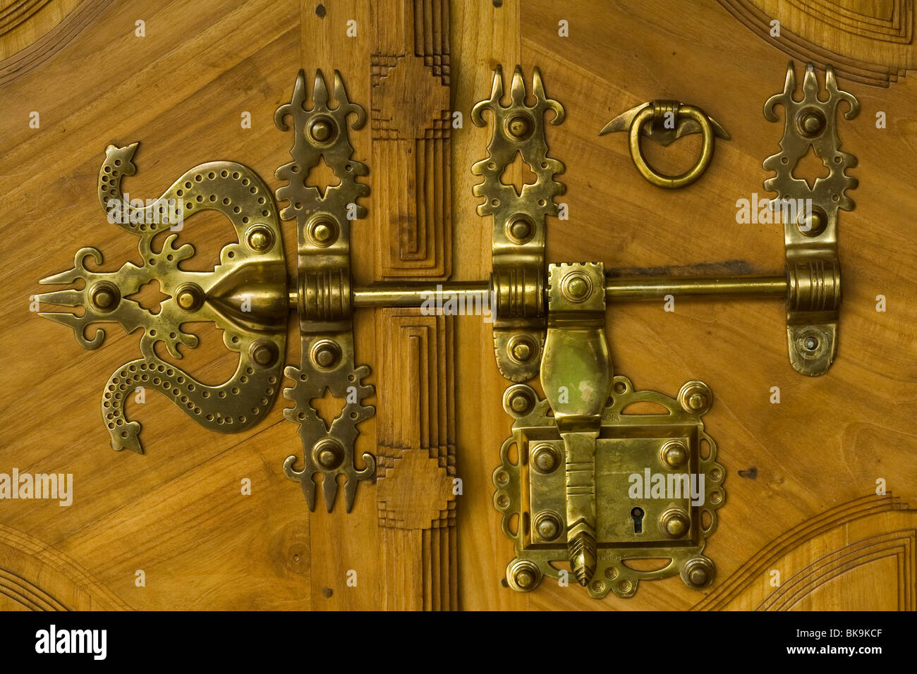 Antique traditional brass door latch and lock on wooden doors common in  kerala india locally known as manichithrathazhu - Antique Traditional Brass Door Latch And Lock On Wooden Doors