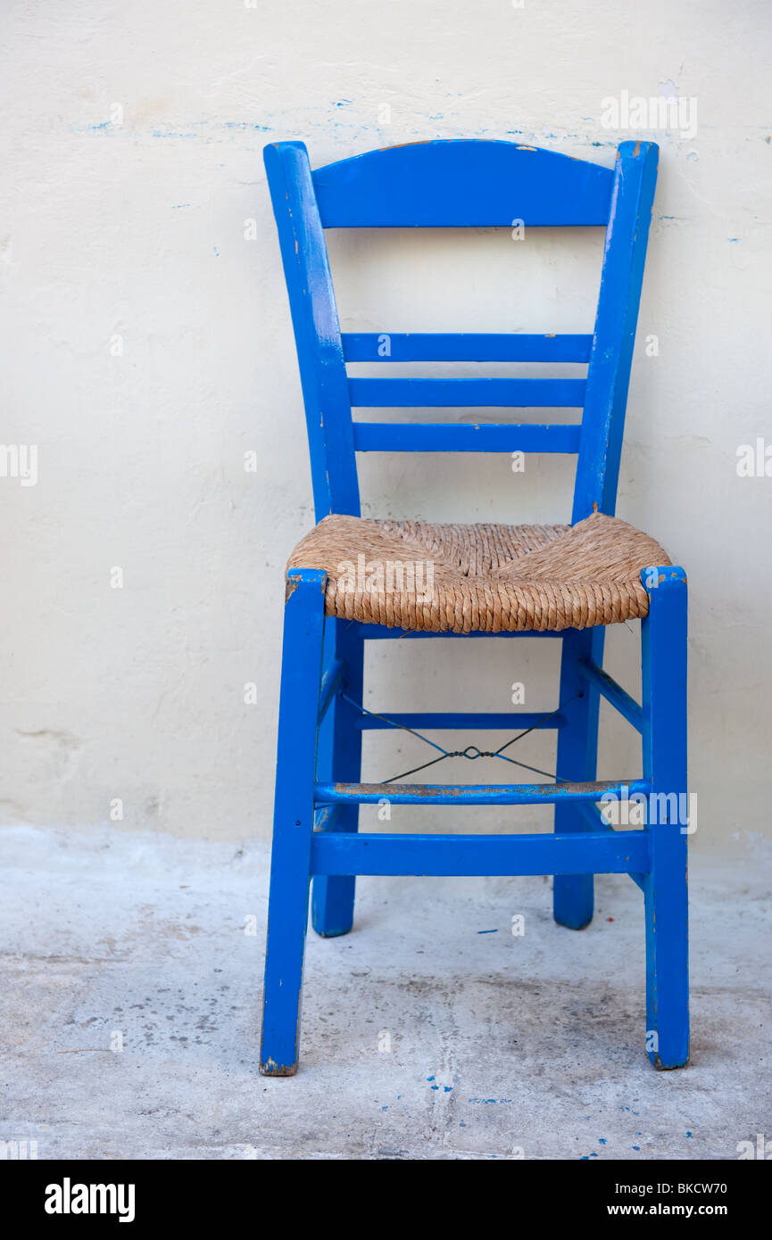 Typical Blue Greek Chair In Front Of A White Wall