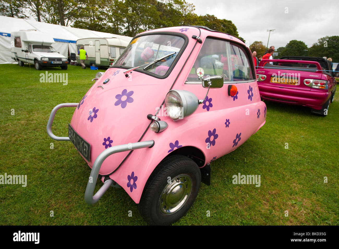 Bright pink bmw isetta bubble car stock image