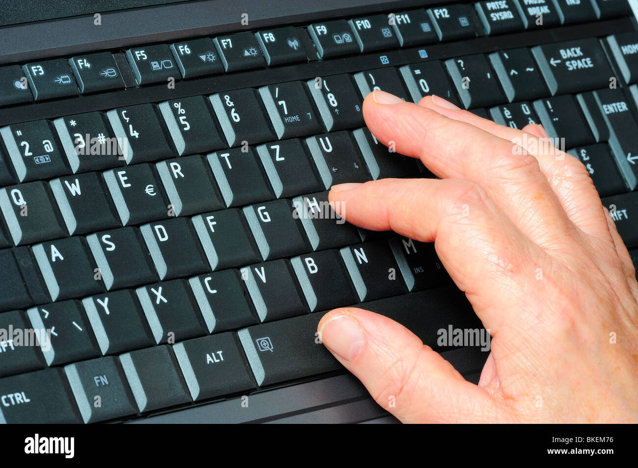 Close up view of a person using a french computer keyboard qwertz close up view of a person using a french computer keyboard qwertz with accented letters and other differences from the english spiritdancerdesigns Images