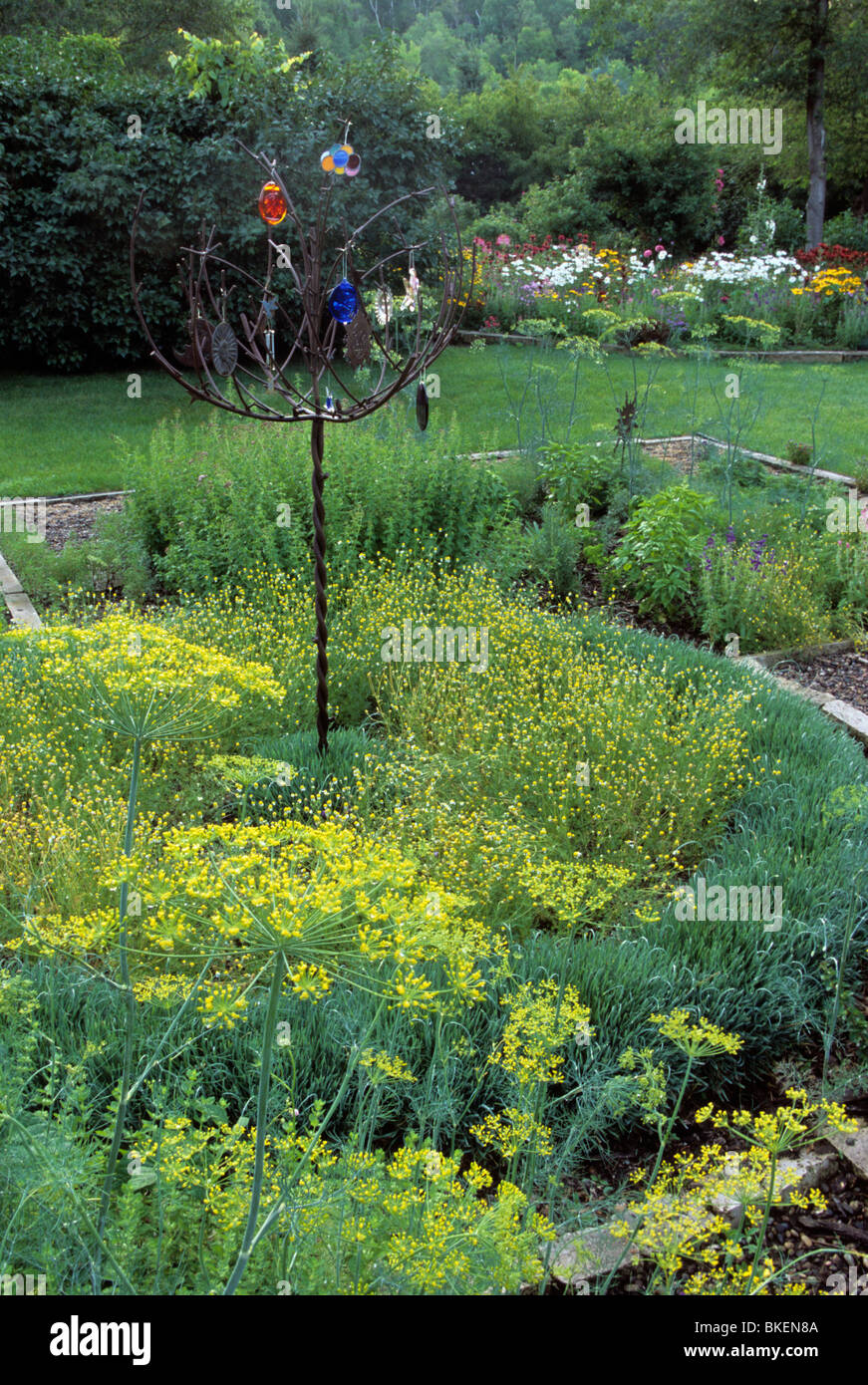MINNESOTA KITCHEN GARDEN WITH IRON FRIENDSHIP TREE, CHAMOMILE, DILL,  OREGANO, BASIL AND ORNAMENTAL CHIVES.