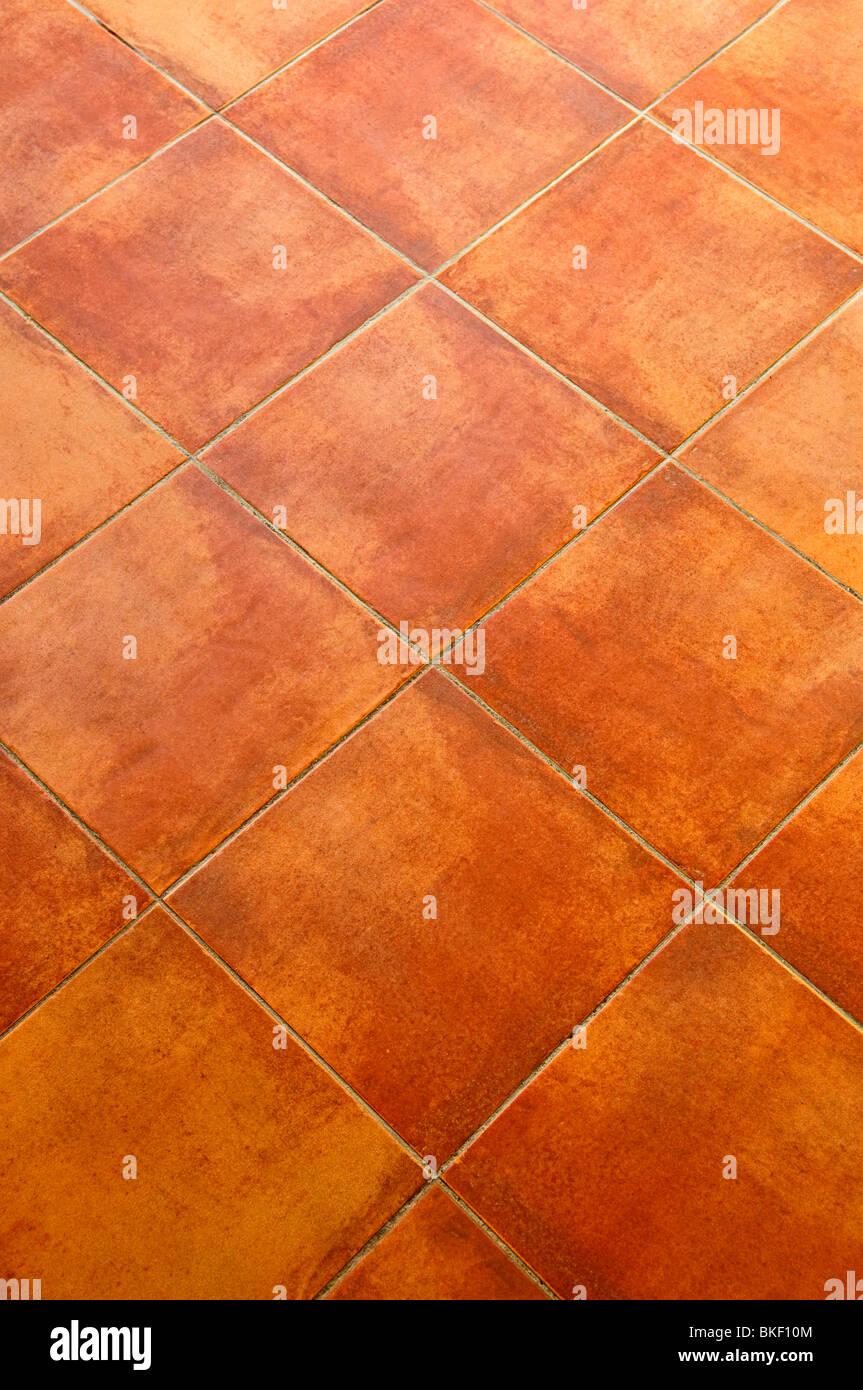 Closeup of square terracotta ceramic tile floor background stock closeup of square terracotta ceramic tile floor background dailygadgetfo Images