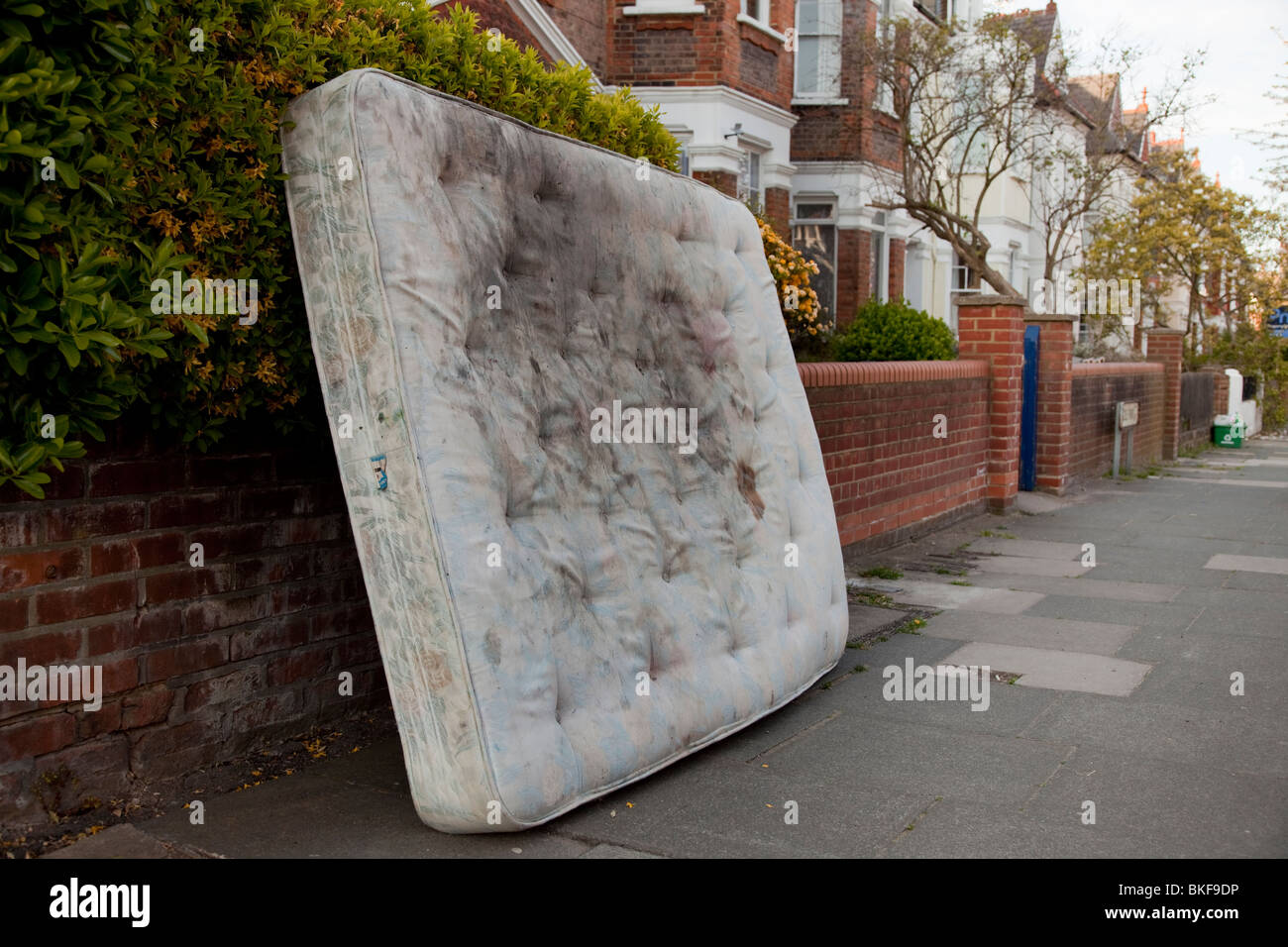 Dirty mattress left in a North London Street Stock