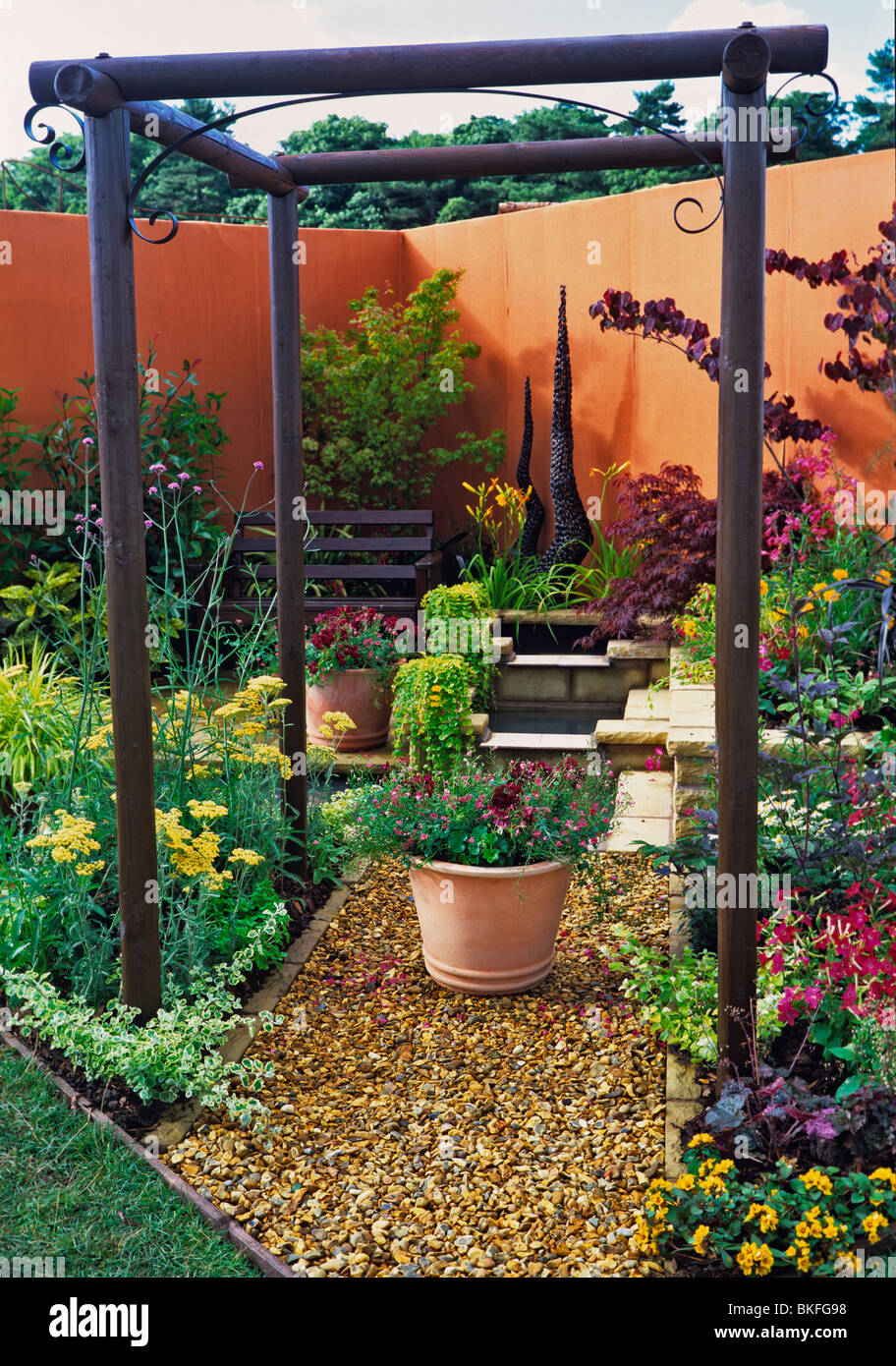 A colourful urban terraced garden with containers and for Ornamental garden features