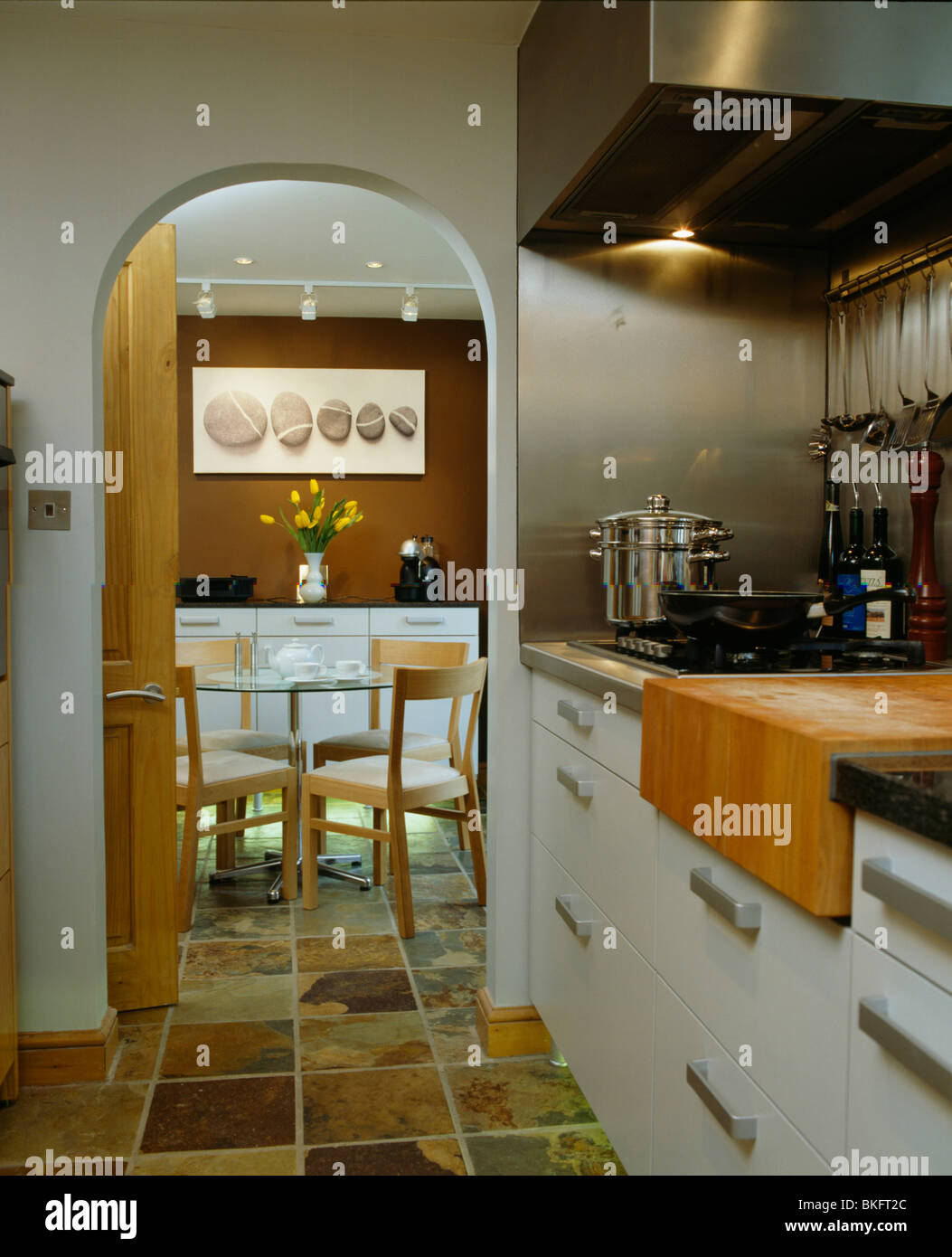 Flooring For Dining Room Modern Kitchen With Arched Doorway And Tiled Flooring To Dining