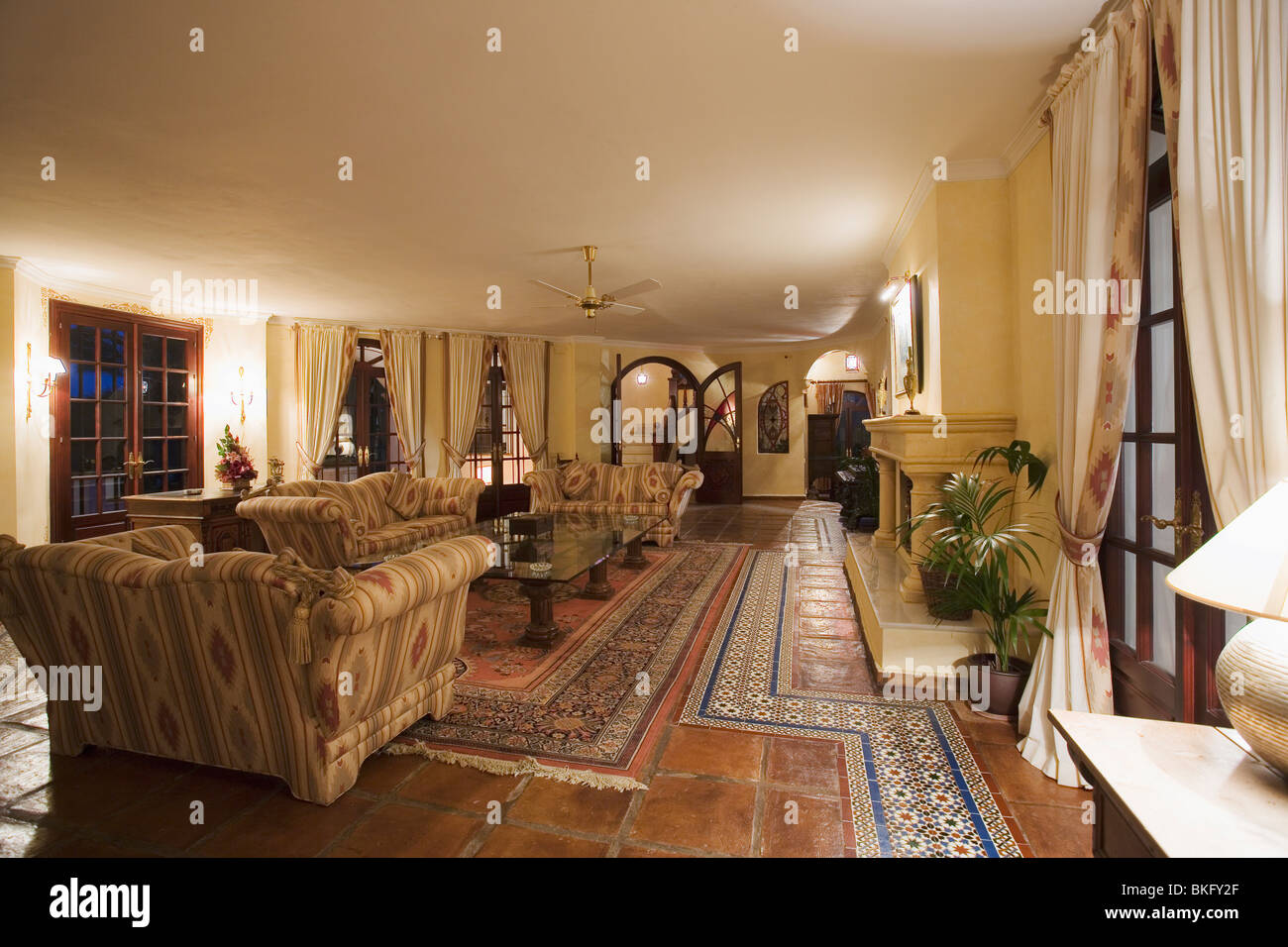 Terracotta and moroccan floor tiles on floor of large spanish country stock photo royalty free for Terracotta living room ideas