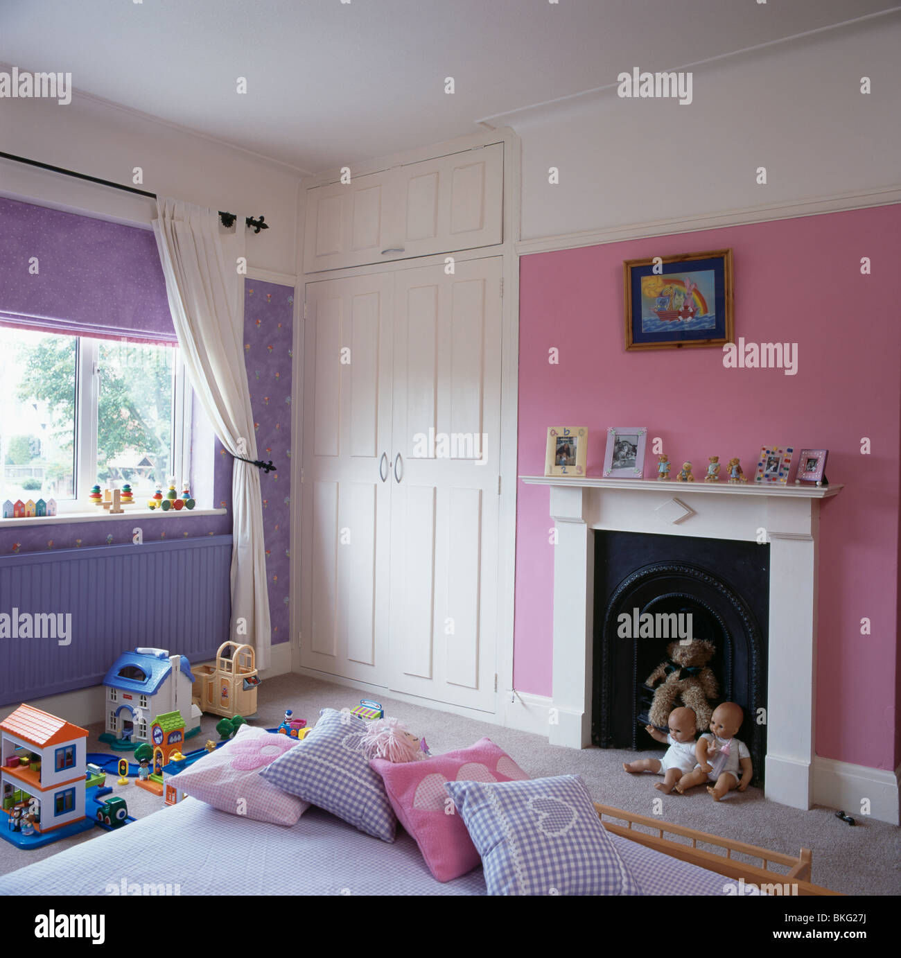 Childs Bedroom pink and mauve child's bedroom with white fitted wardrobe and