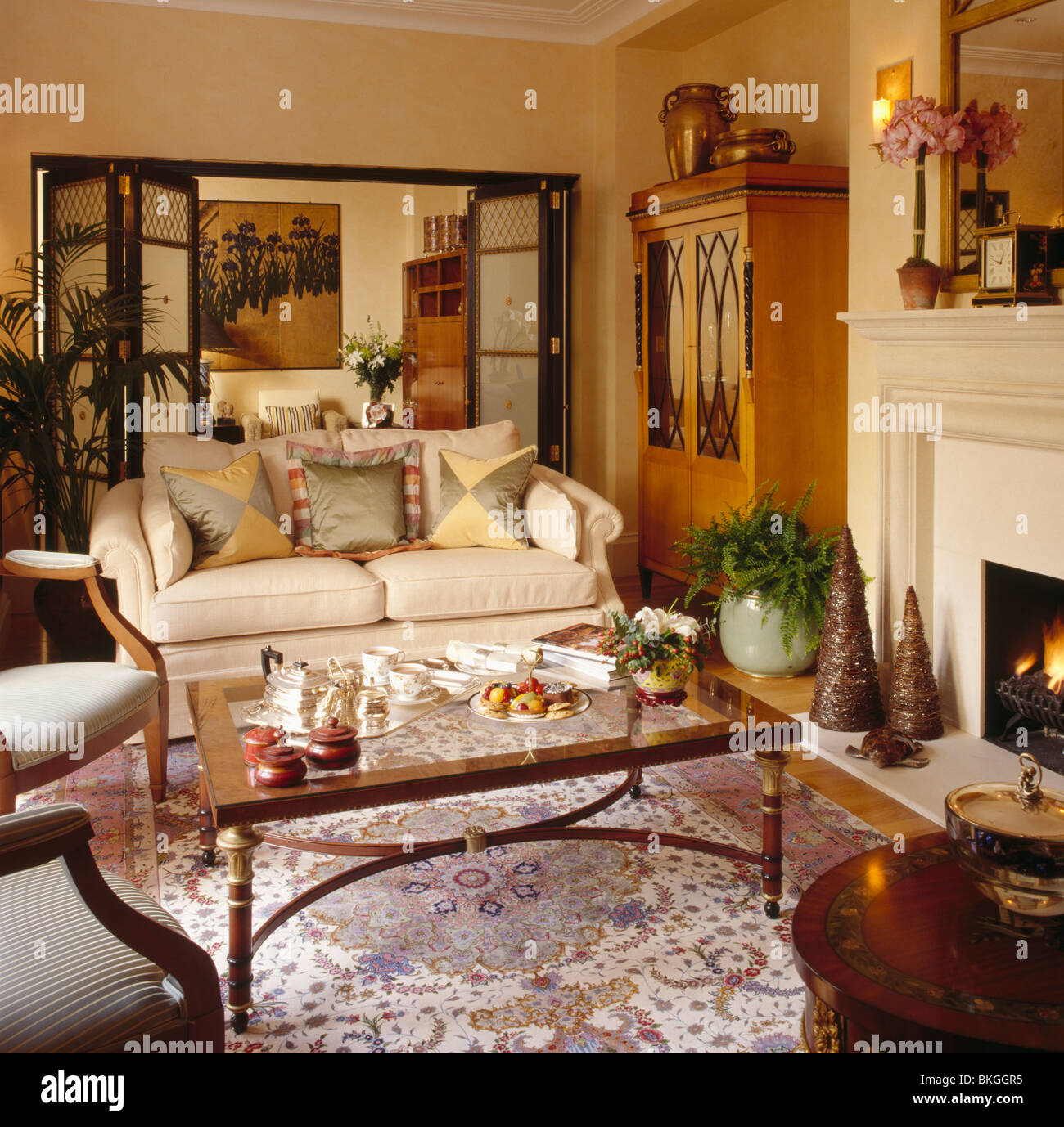 tea set on coffee table in front of fireplace in townhouse living