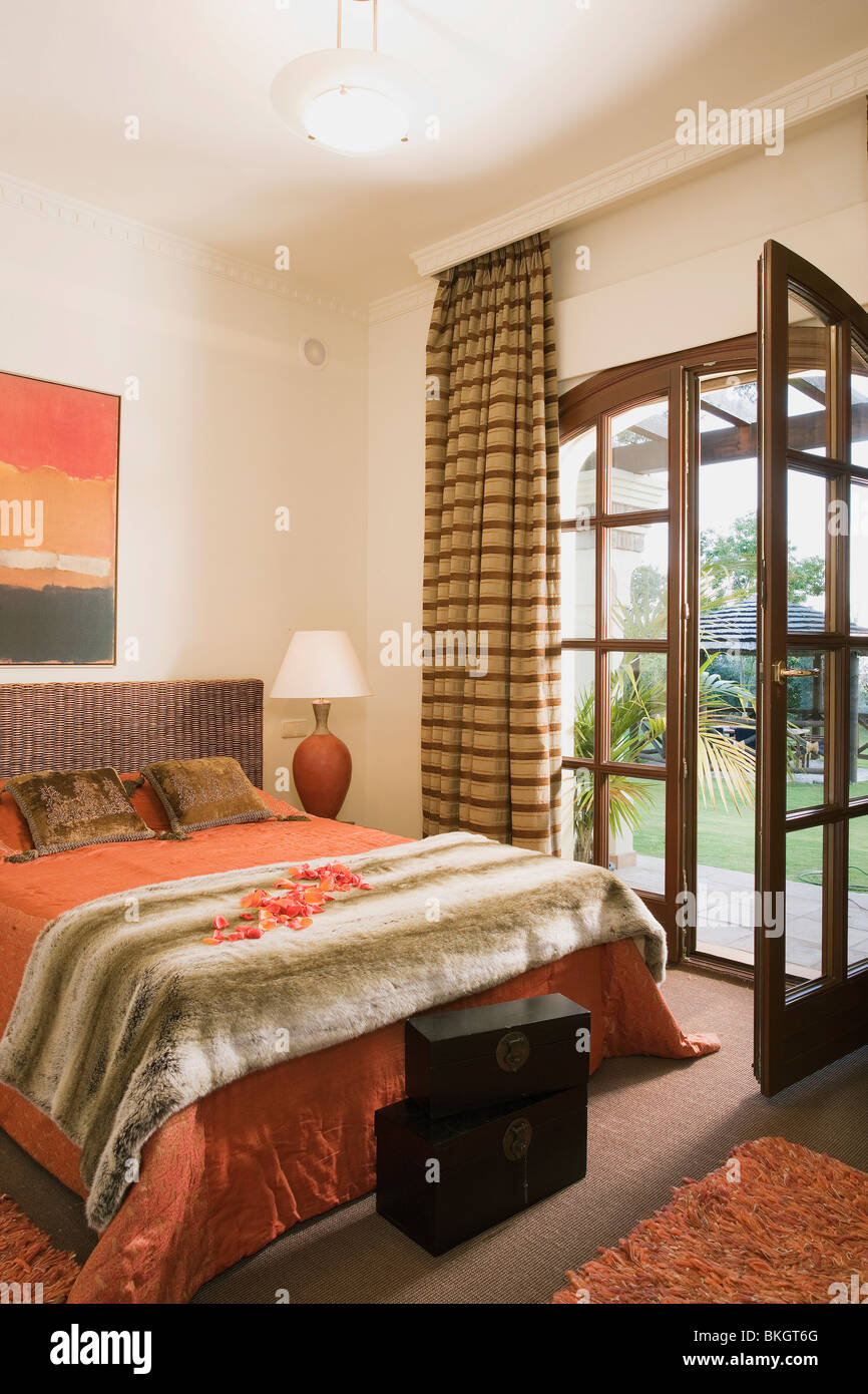 Orange curtains bedroom - Faux Fur Throw On Bed With Orange Bedlinen In Spanish Bedroom With Striped Curtains On