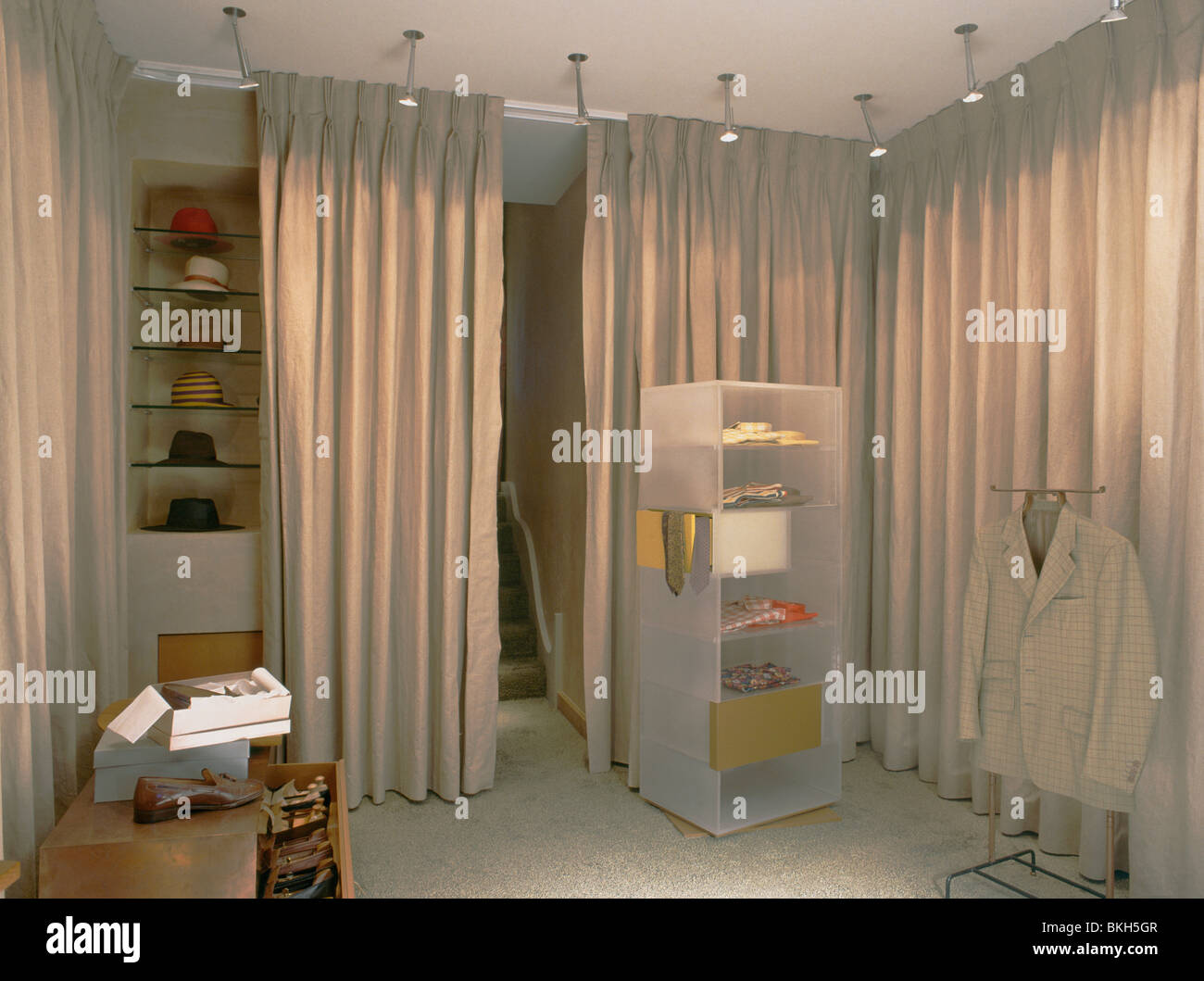 Spotlights Above Perspex Shelving In Dressing Room With