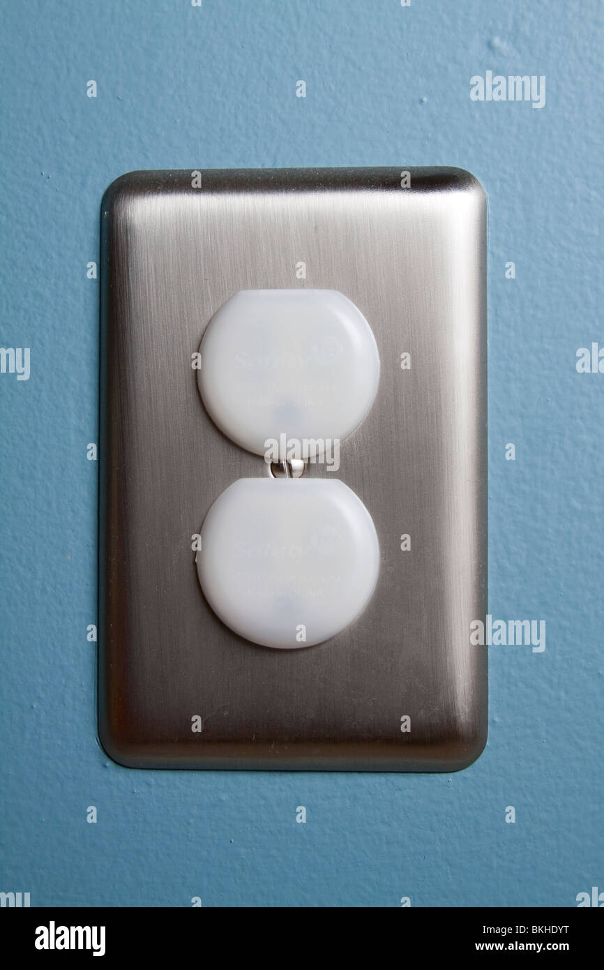 A North American electrical outlet with safety plugs and a stainless ...