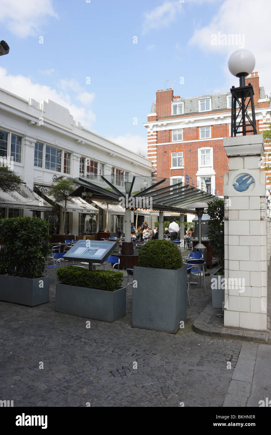 Glass canopy on the forecourt of the Bluebird Restaurant a finetrendy eatery in Kings Road Chelsea & Glass canopy on the forecourt of the Bluebird Restaurant a Stock ...
