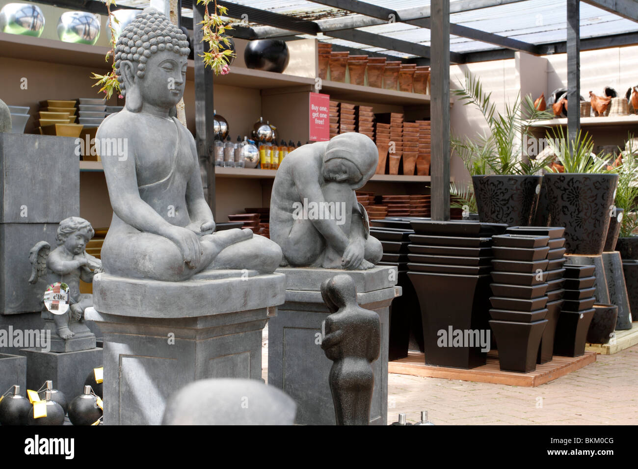Statues And Pots On Racks At Brookfields Garden Centre