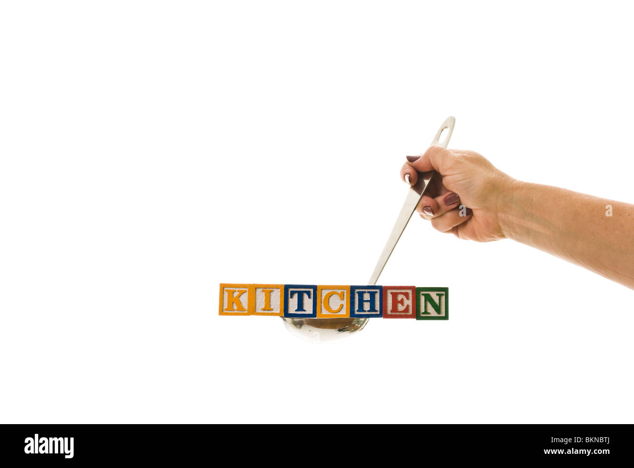 Woman with a ladle holding children\'s blocks that spell \