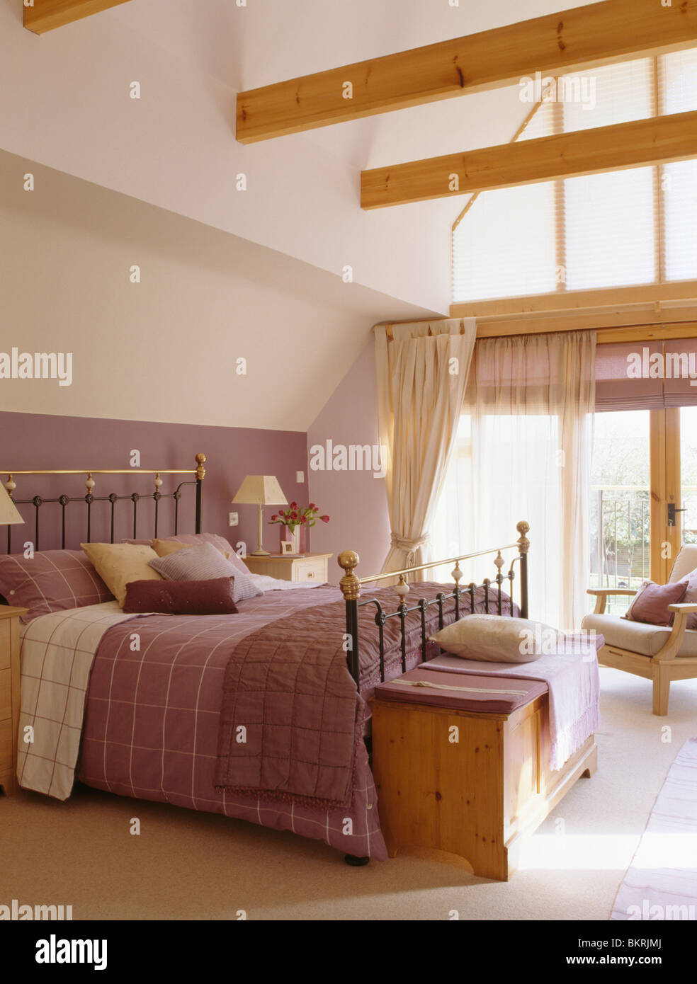 Mauve Bedroom Wooden Chest Below Antique Brass Bed With Mauve Bed Linen In Large