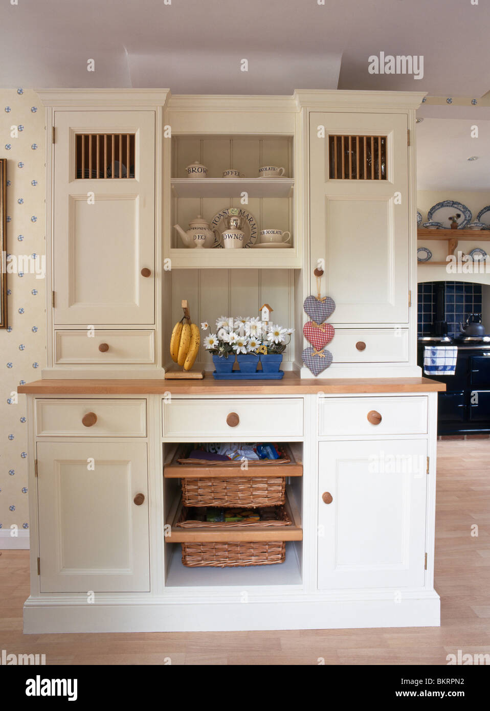 Cream Fitted Kitchen Dresser With Integral Storage Baskets In Country  Kitchen
