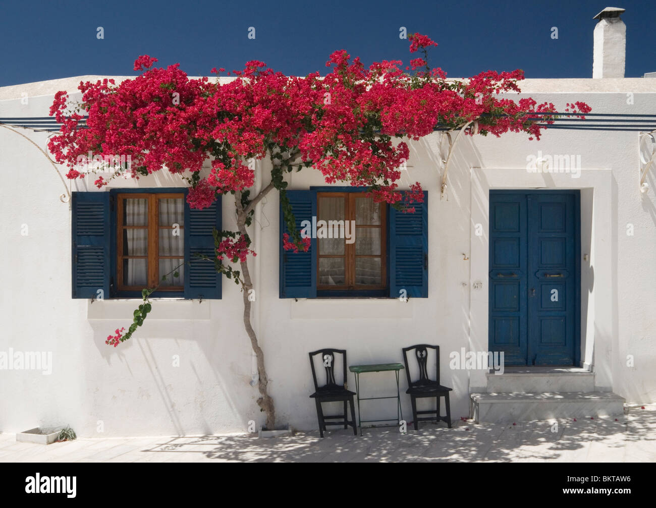 Greek Style House greek island cycladic style house with red bougainvillea providing