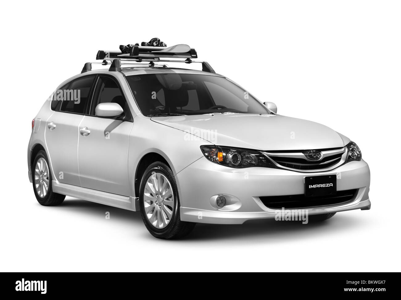 2010 Subaru Impreza 2.5i 5 Door Car With A Snowboard On The Roof Rack  Isolated On White Background