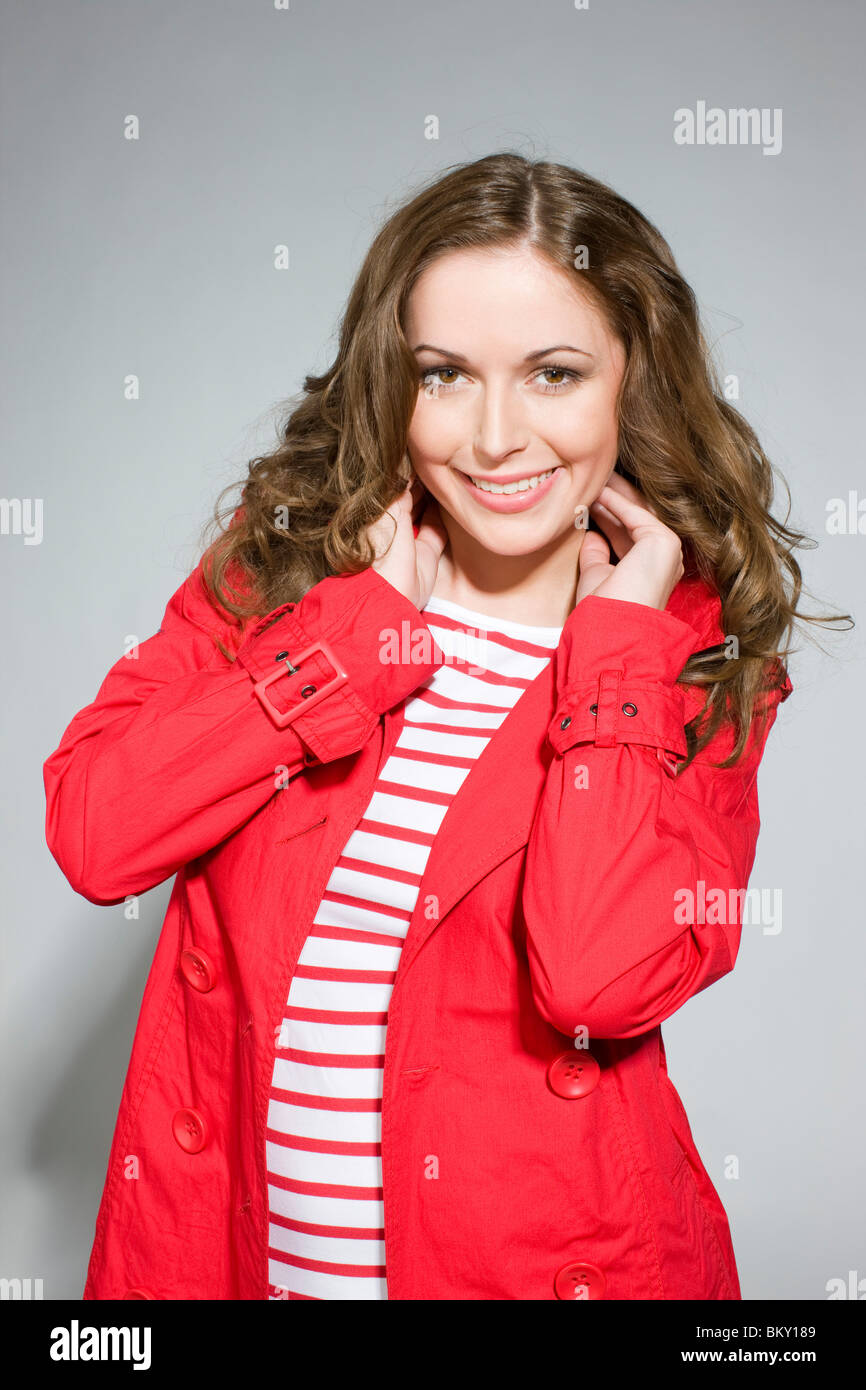 young woman in red coat Stock Photo, Royalty Free Image: 29482553 ...