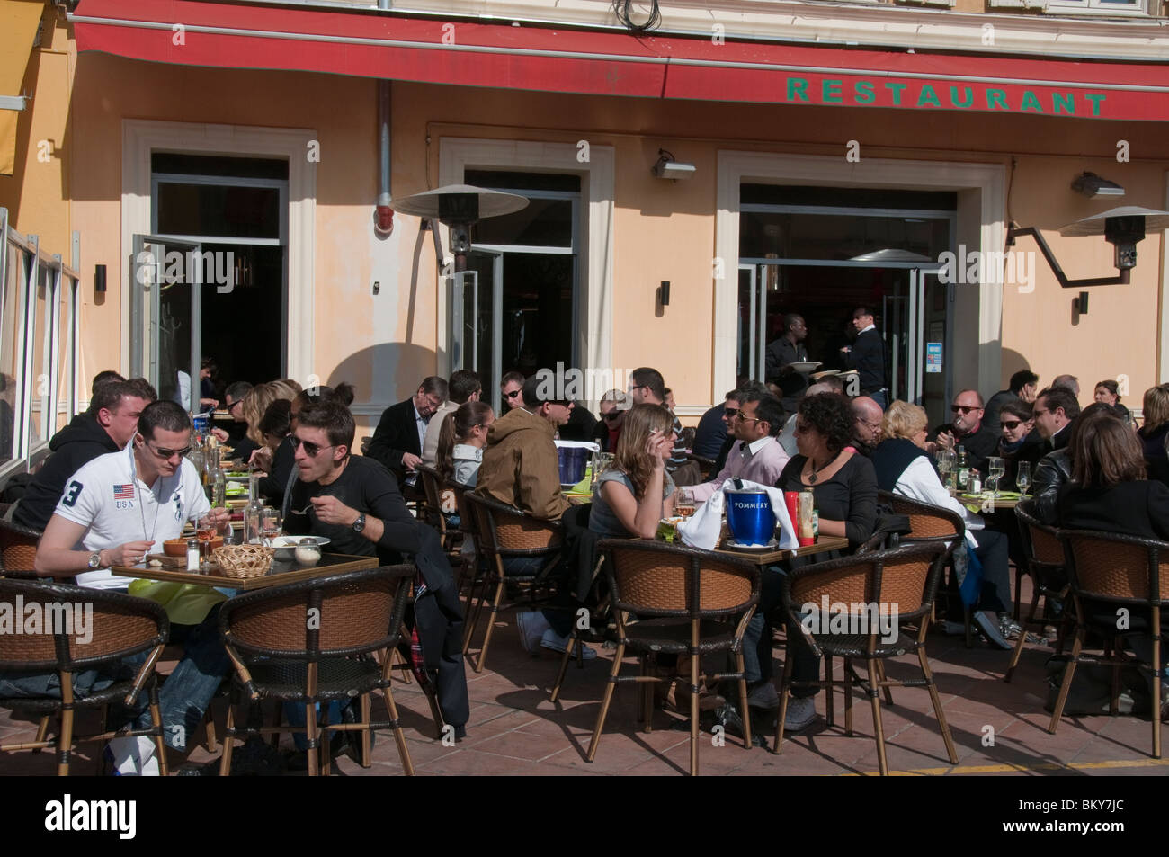 Crowded restaurant table - Nice France French People Sharing Meals And Drinks In Caf French Bistro Restaurant Outside On Sidewalk Crowded Terrace