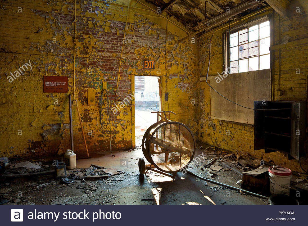 abandoned warehouse with peeling yellow paint on the walls. Black Bedroom Furniture Sets. Home Design Ideas