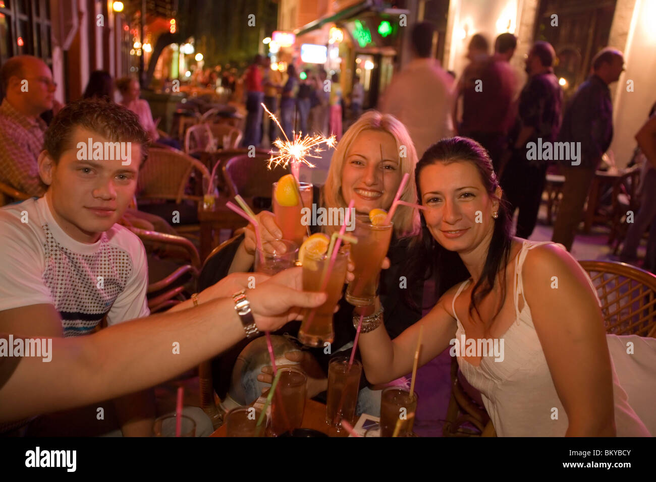 Gallery images and information kos greece nightlife - Young People Toasting With Drinks In An Open Air Bar At Night Kos