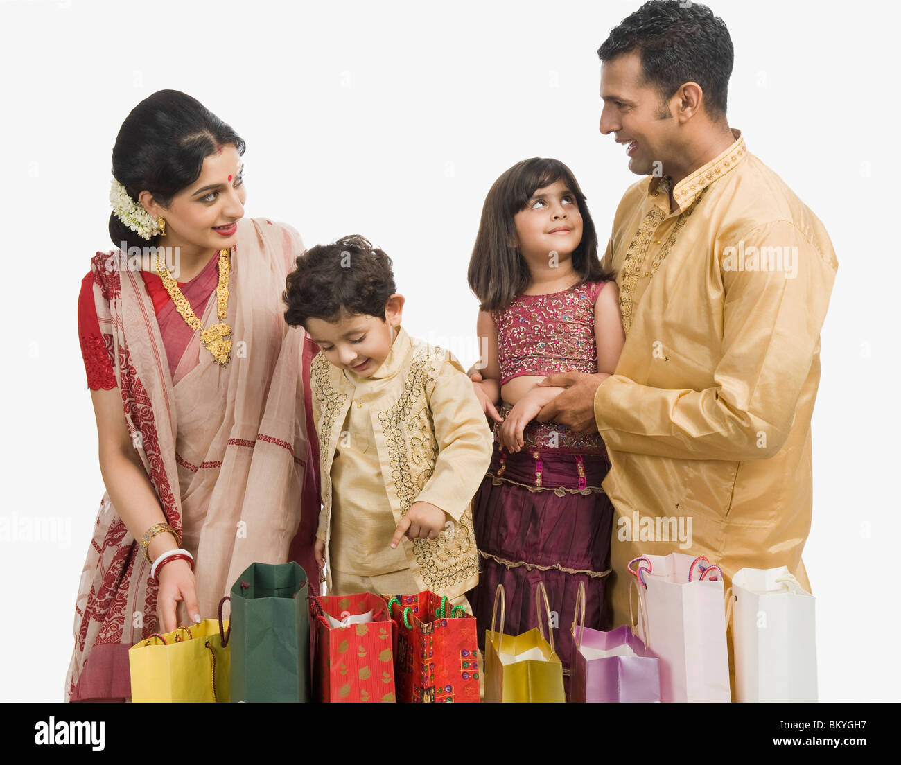 Household Stores: Family With Shopping Bags At Durga Puja Stock Photo