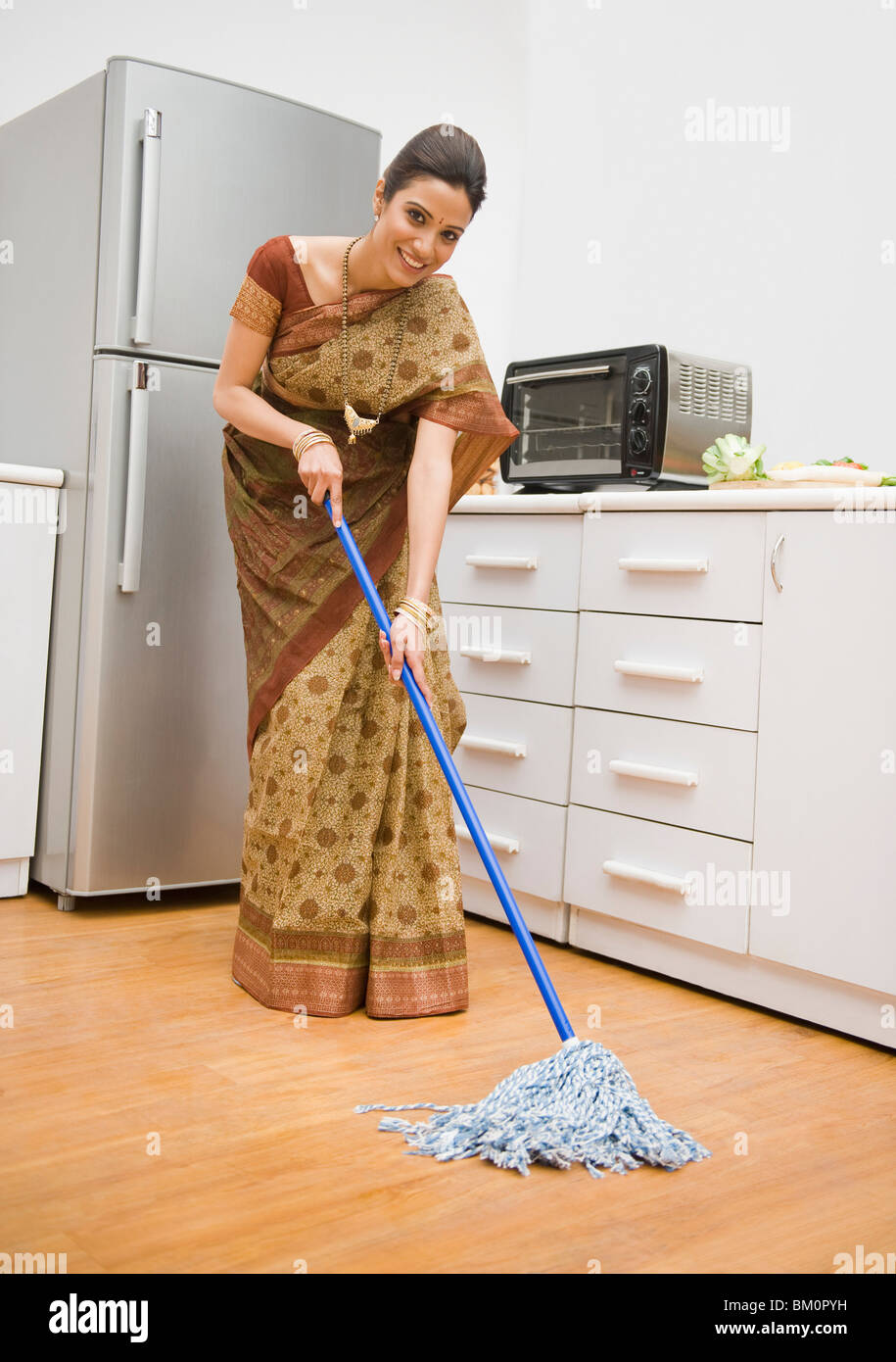 Mopping Kitchen Floor Woman Cleaning Floor With A Mop Stock Photo Royalty Free Image