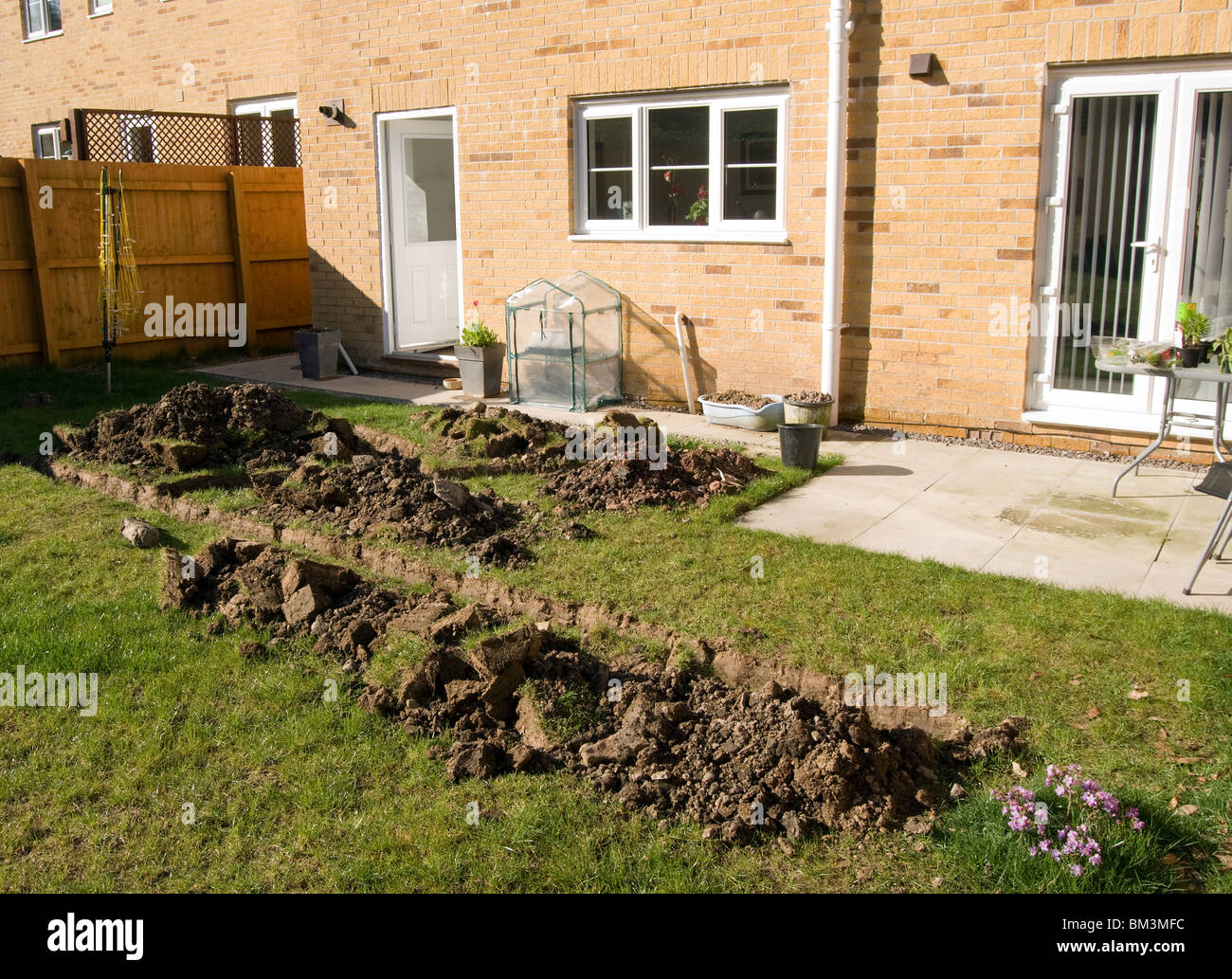 trenches dug into a garden of a new build house in preparation of