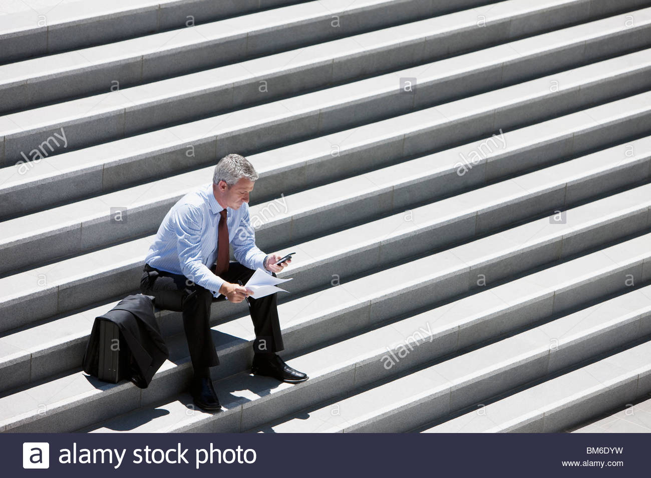 Outdoor Steps Businessman Sitting On Outdoor Steps And Text Messaging Stock