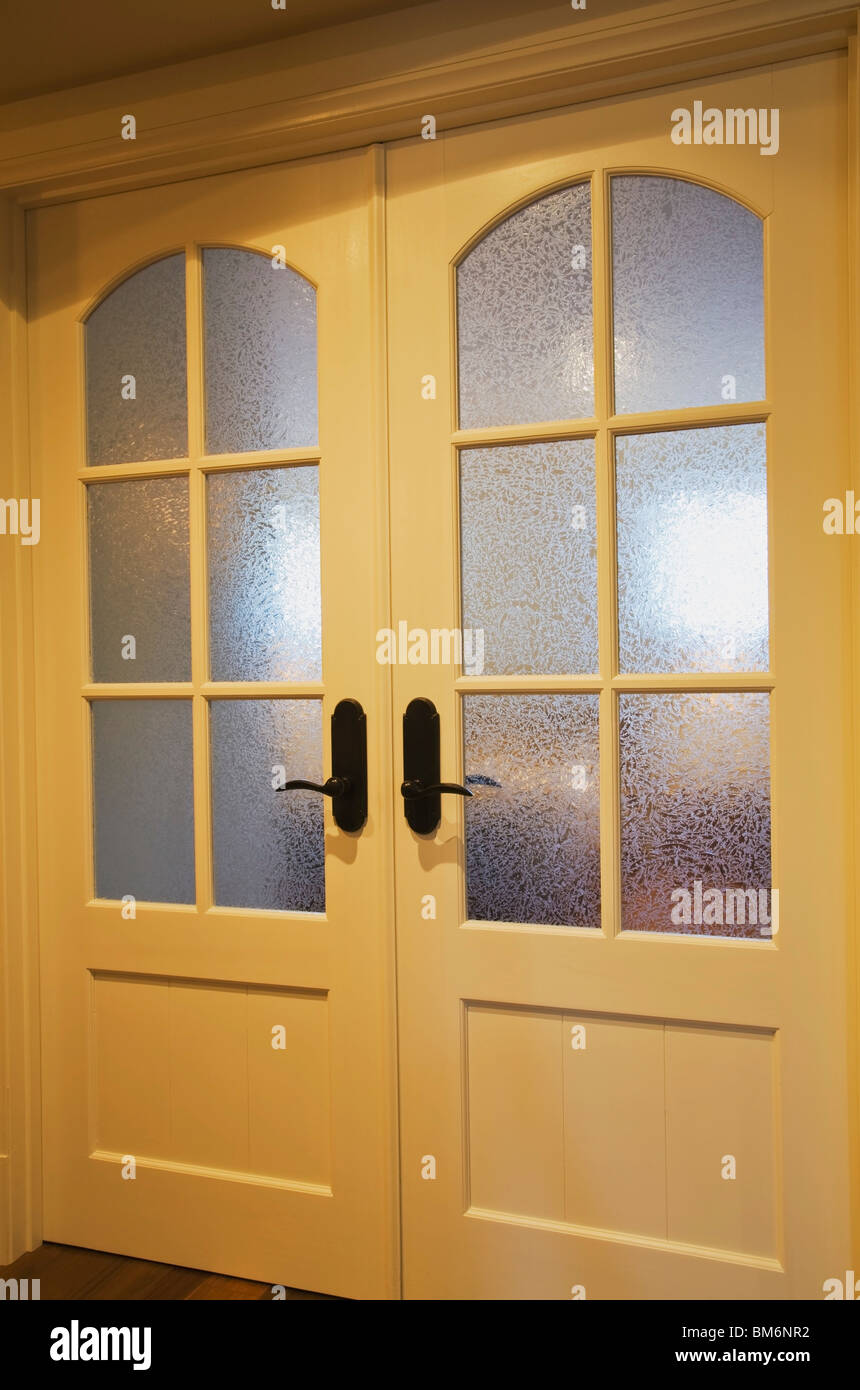 French doors with frosted glass panels in a home stock photo french doors with frosted glass panels in a home rubansaba
