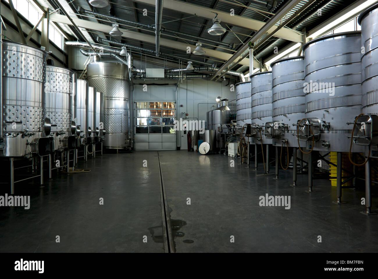 Enormous Wine Cellar : Huge empty stainless steel wine fermentation tanks in