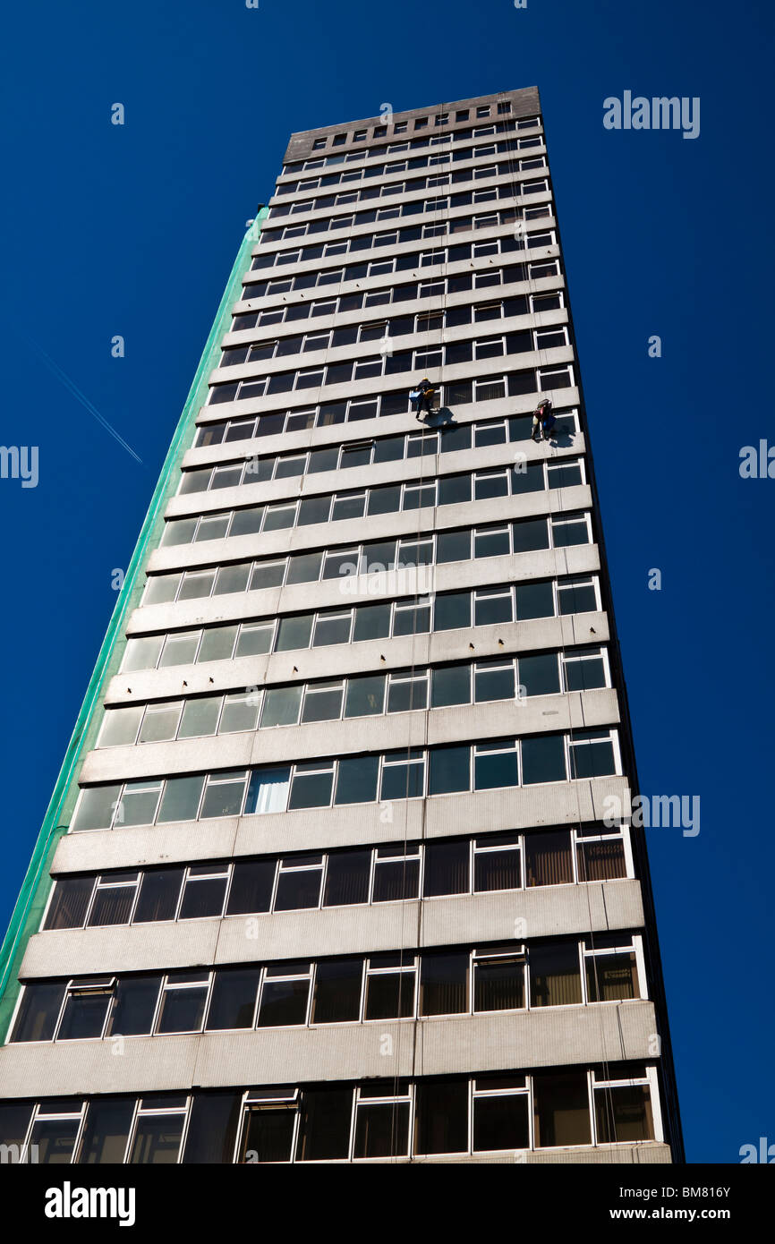 Cleaning windows at windsor house belfast stock photo for Windsor house