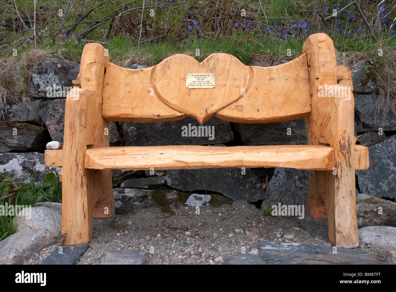 Chainsaw carved wooden bench memorial loch laich