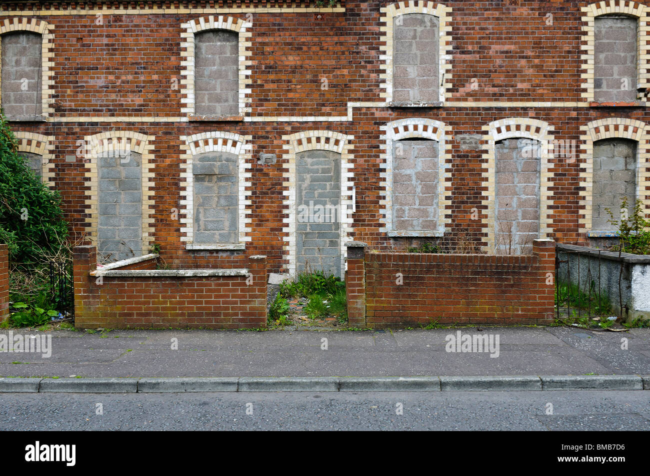 Abandoned houses with bricked up windows and doors in an inner city street in Belfast : doors belfast - pezcame.com