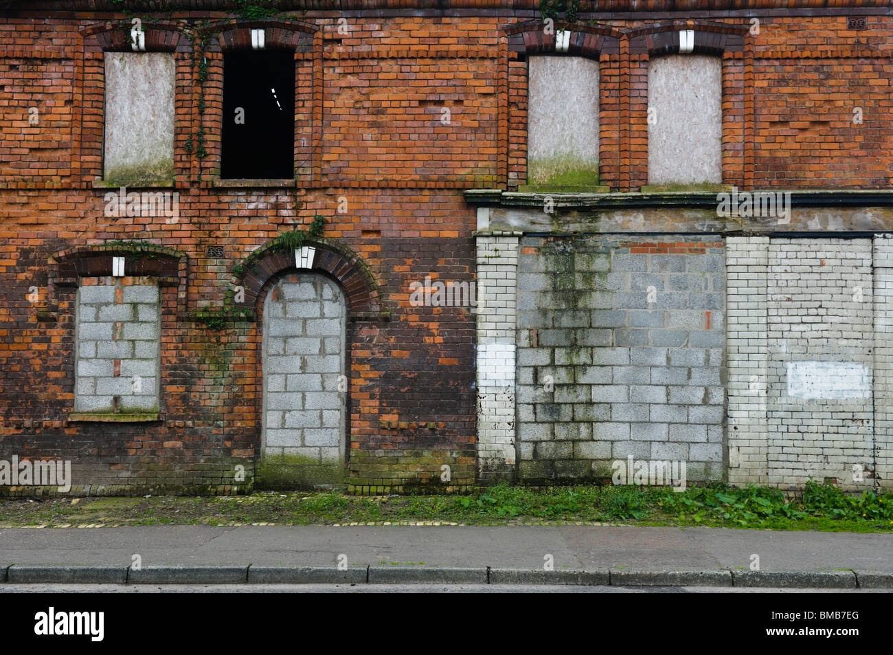 Abandoned house and shop with bricked up windows and doors in a street in Belfast & Abandoned house and shop with bricked up windows and doors in a ... Pezcame.Com